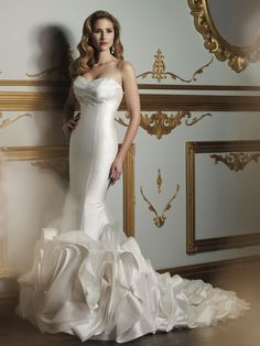 Strapless Mikado and organza princess seamed trumpet gown with sweetheart neckline.