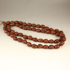 Chinese Olive Nut Arhat Heads Necklace