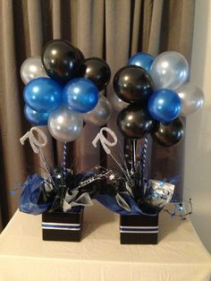 Blue, silver and black balloon topiary trees
