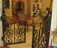 Baby gate. I wonder if we could do this at our next house. So beautiful! I wonder if it would damage to walls too much.,