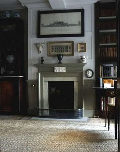 Home office inspiration for a house with original details complete with a reading corner and a masculine library feel and grey colour scheme. Georgian Interiors, Georgian Homes, Georgian Fireplaces, Style Anglais, 1930s House, Ivy House, Antique Interior, Interior Decorating, Interior Design
