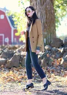 Can't get enough of this chic fall look from Style Me Perfect. She styles our camel double-breasted blazer with a black and white striped turtleneck, cropped flare jeans, and our studded heeled oxfords. The look is topped off with a tied bandana and classic red lips | Banana Republic