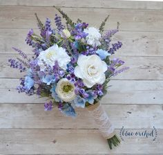 Rustic Wedding Bouquet, Blue and Lavender Wildflower Bouquet with Cream Ranunculus and Thistle by blueorchidcreations on Etsy https://www.etsy.com/listing/245946672/rustic-wedding-bouquet-blue-and-lavender