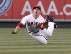Game #28 5/5/12: Los Angeles Angels center fielder Mike Trout makes a diving catch off a fly ball hit by Toronto Blue Jays catcher J.P. Arencibia in the third inning of a baseball game in Anaheim, Calif., on Saturday May 5, 2012. (AP Photo/Christine Cotter)