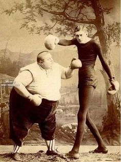 I wonder where this came from. Not sure what's weirder. The disparity in physique or the way they're punching out at nothing.
