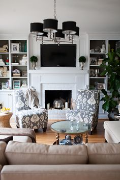 bookcase styling, eclectic family room, Ikat chairs