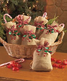 "The delightful Set of 6 Burlap & Berry Treat Bags brings rustic flair to your gifts. Use them to wrap small presents or as goodie bags at parties. The burlap sacks have drawstring tops with decorative plaid ribbons. 4-1/2""W x 7""L, each. Burlap, fabric an"