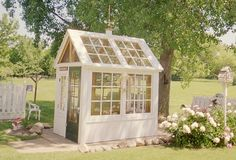 Greenhouse / garden shed created from old windows that were removed from a school.  Created by Sara (Calico Apron on Flickr.)