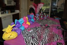 Colorful Sleepover gift bags for guests -filled with matching eyemask, pedicure set, wooly socks; goblets to drink from.