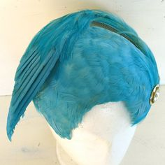 spectacular turquoise blue feather fascinator  by JennyandPearl, $85.00