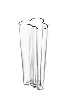 Iittala Aalto 10-Inch Vase, Clear. Glass vase, a true 20th-century design icon. Inspired by Finnish architect Alvar Aalto's award-winning 1936 vase. Aalto's name inscribed on bottom of vase. Measures 4-3/4 inches high. Made in Finland; wash by hand.