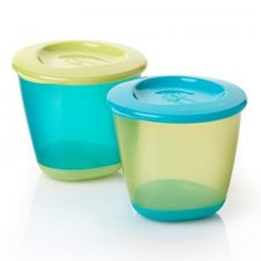 A duo of bright colored, plastic four-ounce pots for freezing pureed baby food.