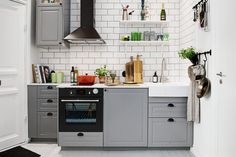 Home & Apartment:Classic Ikea Kitchen Ideas Gray Storage Cabinets White Tile Backsplash Scandinavian Kitchen Small Design With White Open Shelves Decoration Beautiful Small Studio Apartment in Gothenburg Inspiring Brightness and Space