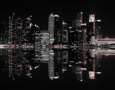 Night in the City Wall Mural: Architecture: Cityscapes: Singapore's night life is reflected off the water, creating a mirror image of the immaculate scene.A minimalistic wall mural image that can be printed on demand. Your specifications will be met for any interior design or home decor project. Create your own wallpapers, wall art and more by exploring our extensive collections.