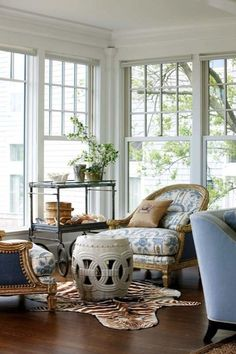 Suzie: New England Home - Gorgeous living room with rope garden stool, zebra cowhide rug, ...