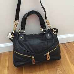 Michael Kors Black Leather Purse Michael Kors Black Leather Purse. Gold hardware. Full disclaimer: inside does have dime sized nail polish stain (OPI ate berries in the canaries to be exact ) outside is pristine. Removeable shoulder strap. MICHAEL Michael Kors Bags Shoulder Bags