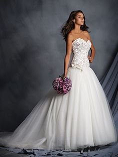 Alfred Angelo Style 2528: Wedding dress of satin and tulle that features a strapless sweetheart satin bodice
