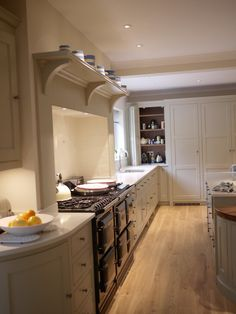 the cabinetry paint colours are Farrow & Ball French Gray and Old White. The walls are decorated with Farrow & Ball Clunch.--ICON INTERIORS