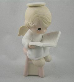 figurines of angels reading books   Sitting Pretty