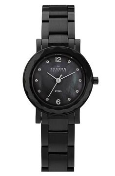Skagen offers another black band watch option with a beautiful black mother of pearl facet. Chic and understated.