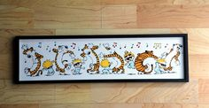 Very cute Calvin and Hobbes Print. Measures approx. 18 x 4 mounted on .5 thick shadow box with a black border.