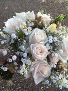 Cream roses, lisanthus, gypsohoila with gold berries brides bouquet. September Wedding Flowers, Seasonal Flowers, Cream Roses, Bride Bouquets, Brides, Floral Wreath, Wreaths, Gold, Decor