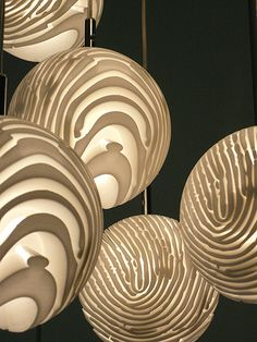 The design for the Detail.MGX lampshade involved the unmistakable pattern of a fingerprint, which when shared, is closely associated with a loss of privacy - in this case, the designer's own. He stretched his print around a sphere, its unique swirls becoming channels through which light could shine.