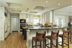 Large and luxurious kitchen design with beautiful kitchen bar stools for the breakfast table.