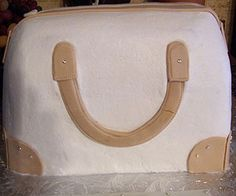How To Make a Purse Cake Tutorial on Cake Central on Cakecentral.com