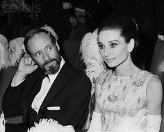 """Audrey Hepburn photographed with her husband Mel Ferrer by Roger Viollet at the Théâtre du Châtelet, located at Place du Châtelet, in the 1er arrondissement of Paris, during the French premiere of her new movie """"My Fair Lady"""", on December 22, 1964"""