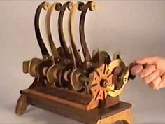 As the crank turns, five wooden snakes dance to the music of mechanical chaos. (My machines are whimsical celebrations of mechanical movement, in which I've . Wooden Gear Clock, Wooden Gears, Kinetic Toys, Kinetic Art, Mechanical Art, Mechanical Design, Marble Machine, Perpetual Motion, Wood Toys