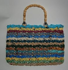 Would you beleive that this bag was made entirely of plastic bags! Yeah, the ones you get at the grocery store! To find out how to make this, follow this link;   http://www.craftster.org/forum/index.php?topic=178442.0