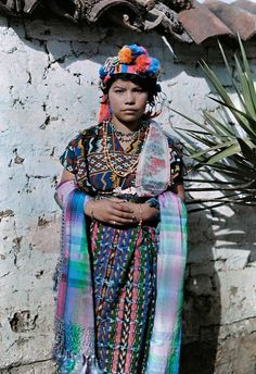 A young girl dressed in traditional clothing leans against a wall in Guatemala, November 1926.PHOTOGRAPH BY JACOB J. GAYER, NATIONAL GEOGRAP...