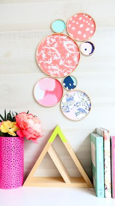 A Kailo Chic Life: DIY It - A Simple Patterned Clock - Turn a boring clock into a beautiful centerpiece with Spoonflower wallpaper.