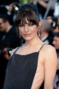 Milla Jovovich Twisted Bun - Milla Jovovich chose a twisted bun to give her a fun and edgy 'do to match her gown at the 'Cleopatra' premiere in Cannes.