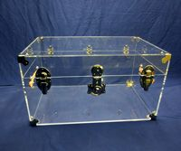 Acrylic Trunk - cheapest online as of Jan 14; $320. From ClearStands.com. Comes with silver hardware.