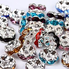 6/8/10mm TOP Quality Bling Brass Mixed Colorful 50pcs Crystal Rhinestone Rondelle Silvery Spacer Beads Findings. $4.50, via Etsy.