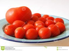A big tomatoes and some cocktail tomatoes