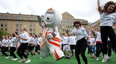 Jumping for Joy - the Olympic mascot 'Wenlock' with students in Edinburgh!