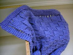 Designed by Melissa Leedom Easy basketweave baby blanket will also give you a little practice with lace knitting for the edges.   beautiful my next project?