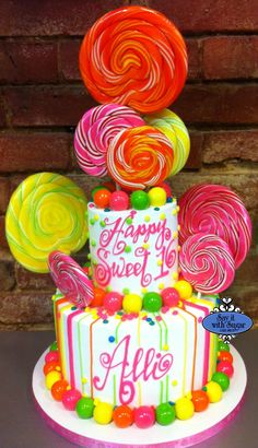 Candy themed cake ...too many suckers!