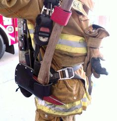 how do firefighters carry their axe - Google Search