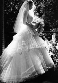 The clever use of layers and layers of light diffusing tulle, edged in lace to create this tiered effect wedding dress. Bridal Skirts, Bridal Gowns, Wedding Gowns, Bling Wedding, Tulle Wedding, Wedding Flowers, Vintage Wedding Photos, Vintage Bridal, Vintage Weddings