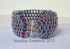 "This dragonscale cuff is such a cool bracelet....the colorful smaller rings are nestled inside the bright aluminum rings and the 2"" cuff sets off any outfit! The cotton candy colors can be interchanged with any color combination you desire....over 675 rings and 8 hours of work make up this cuff. $75 Small Rings, 8 Hours, Nautilus, Candy Colors, New Toys, Cotton Candy, Color Combinations, Art Pieces, Make Up"