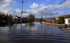 A flooded street is seen in urban landscape taken in the flooded Somerset village of Moorland February 16, 2014. (Reuters)