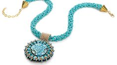 Sunburst button necklace by Sue Neel.  Use a beautiful turquoise button as the focal piece of a bead-embroidered pendant, and display it on an intriguing picot stitch rope. Turquoise beads. Free project. Free jewelry making project. Bead&Button magazine. FacetJewelry.com. Facet Jewelry.