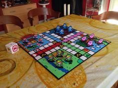 Made this board game Ludo in collaboration with See more pictures … – Geeks – Hama Beads Perler Bead Designs, Perler Bead Templates, Hama Beads Design, Pearler Bead Patterns, Diy Perler Beads, Perler Bead Art, Perler Patterns, Pearler Beads, Fuse Beads