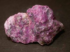 Stichtite,  Mg6Cr2(CO3)(OH)16•4(H2O), stichtite Hill, Dundas, Zeehan District, Tasmania, Australia. Purple rough 46x30mm specimen.  Copyright: John Sobolewski