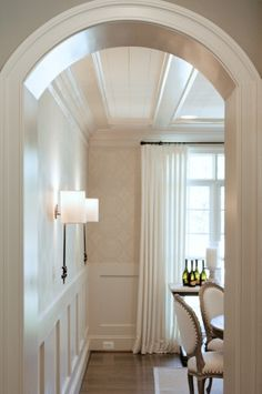 walls. ceiling. curved entry.    traditional dining room by Dream House Studios