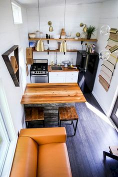 Tiny House Giveaway by Lamon Luther – Tiny Living This 368 sq. tiny house features a full kitchen with a beautiful reclaimed wood island that doubles as a table, a freestanding range, and apartment-size refrigerator. Tiny Studio Apartments, Studio Apartment Layout, Apartment Design, Micro Apartment, Studio Apartment Kitchen, Apartment Ideas, Studio Kitchen, Apartment Furniture, Bedroom Apartment